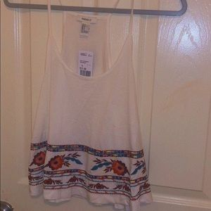 New cami top, w/ flowers embroidered at the bottom